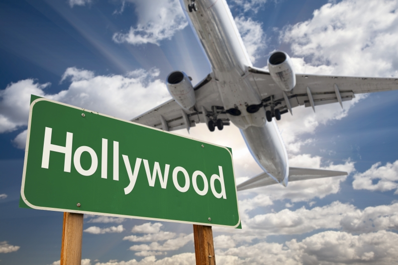 9890368-hollywood-green-road-sign-and-airplane-above